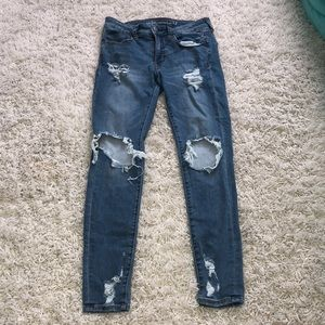 Ripped medium washed skinny jeans